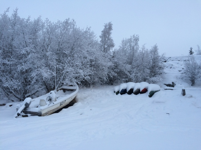 Canoes waiting for spring and open water